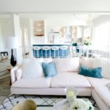 HGTV, open concept, kitchen, Ikea, living room, pink sofa, lighting, black, bar, wet bar, brass, ocean, kitchen, rattan, pineapple, gold, brass, Homegoods, Marilyn Taylor, copper, teal, turquoise